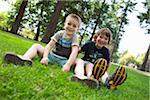 Portrait of Boys Sitting on Grass, Washington Park, Portland, Oregon, USA Stock Photo - Premium Royalty-Free, Artist: Ty Milford, Code: 600-03865194
