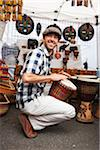 Man Playing Drum at Booth in Market Stock Photo - Premium Rights-Managed, Artist: Ty Milford, Code: 700-03865237