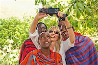 Woman Taking Self-Portrait with Group of Masai Men Stock Photo - Premium Rights-Managednull, Code: 700-03865404