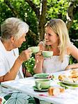Two women having a cup of coffee outdoors, Stockholm, Sweden. Stock Photo - Premium Royalty-Free, Artist: Kablonk! RM, Code: 6102-03866211