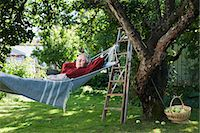 single fruits tree - A woman in a hammock, Sweden. Stock Photo - Premium Royalty-Freenull, Code: 6102-03866942