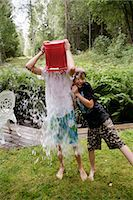 preteen shower pic - Boys playing with water in a garden a summer day, Sweden. Stock Photo - Premium Royalty-Freenull, Code: 6102-03867252