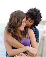 A young couple hugging, Portugal. Stock Photo - Premium Royalty-Freenull, Code: 6102-03867366