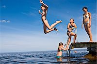 preteen girls bath - Mother and daughters swimming, Oland, Sweden. Stock Photo - Premium Royalty-Freenull, Code: 6102-03867490