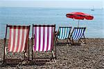 Coloured deck chairs on the pebble strand, Brighton, Sussex, England, United Kingdom, Europe Stock Photo - Premium Rights-Managed, Artist: Robert Harding Images, Code: 841-03868136