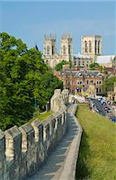York Minster, northern Europe's largest Gothic cathedral, and a section of the historic city walls along Station Road, York, Yorkshire, England, United Kingdom, Europe Stock Photo - Premium Rights-Managednull, Code: 841-03868215