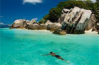seychelles - Local man swimming at the Granite rocks at Ile aux Cocos, Seychelles, Indian Ocean, Africa Stock Photo - Premium Rights-Managednull, Code: 841-03871141
