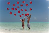 release - Couple playing with balloons on beach Stock Photo - Premium Royalty-Freenull, Code: 649-03881520