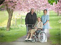 Older couple with caretaker in park Stock Photo - Premium Royalty-Freenull, Code: 649-03883674