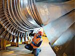 Worker inspects turbine in power station Stock Photo - Premium Royalty-Free, Artist: Robert Harding Images, Code: 649-03883722