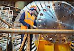 Worker inspects turbine in power station Stock Photo - Premium Royalty-Free, Artist: Transtock, Code: 649-03883725