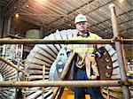 Worker with turbine in power station Stock Photo - Premium Royalty-Free, Artist: Transtock, Code: 649-03883727