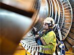 Worker inspects turbine in power station Stock Photo - Premium Royalty-Free, Artist: Arcaid, Code: 649-03883728