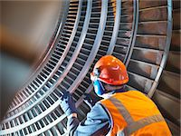 Worker inspects turbine in power station Stock Photo - Premium Royalty-Freenull, Code: 649-03883731