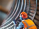Worker inspects turbine in power station Stock Photo - Premium Royalty-Free, Artist: Transtock, Code: 649-03883731