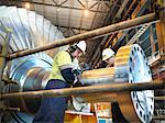 Workers inspect turbine in power station Stock Photo - Premium Royalty-Free, Artist: Cultura RM               , Code: 649-03883733