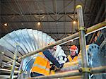 Workers inspect turbine in power station Stock Photo - Premium Royalty-Free, Artist: Robert Harding Images, Code: 649-03883734