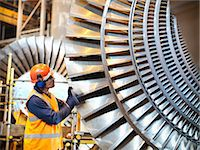 Worker inspects turbine in power station Stock Photo - Premium Royalty-Freenull, Code: 649-03883736