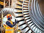 Worker inspects turbine in power station Stock Photo - Premium Royalty-Free, Artist: Transtock, Code: 649-03883736