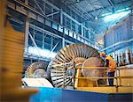 Worker inspects turbine in power station Stock Photo - Premium Royalty-Free, Artist: Arcaid, Code: 649-03883743