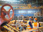 Workers with turbines in power station Stock Photo - Premium Royalty-Free, Artist: Transtock, Code: 649-03883748
