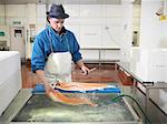 Worker filleting salmon in plant Stock Photo - Premium Royalty-Freenull, Code: 649-03883811