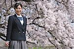 Teenage Girl In School Uniform Smiling Under Blooming Tree Stock Photo - Premium Rights-Managed, Artist: Aflo Relax, Code: 859-03884737