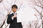 Businessman Standing Under Blooming Cherry Tree And Holding Whiteboard Stock Photo - Premium Rights-Managed, Artist: Aflo Relax, Code: 859-03884968