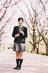 High School Girl Standing On Pathway With Cherry Blossoms In Background Stock Photo - Premium Rights-Managed, Artist: Aflo Relax, Code: 859-03884980