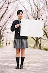 High School Girl Standing On Pathway And Holding Whiteboard Stock Photo - Premium Rights-Managed, Artist: Aflo Relax, Code: 859-03884981