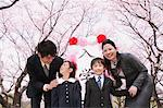 Group Portrait Of Japanese Family Under Blooming Trees Stock Photo - Premium Rights-Managed, Artist: Aflo Relax, Code: 859-03884993