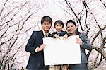 Parents With Their Son Holding Whiteboard Stock Photo - Premium Rights-Managed, Artist: Aflo Relax, Code: 859-03884998