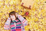 Japanese Women Lying On Ginkgo Leaves Stock Photo - Premium Rights-Managed, Artist: Aflo Relax, Code: 859-03885464
