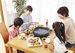 Parents and kids eating Japanese barbeque Stock Photo - Premium Royalty-Free, Artist: Photocuisine, Code: 670-03885849