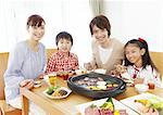 Parents and kids eating Japanese barbeque Stock Photo - Premium Royalty-Free, Artist: Photocuisine, Code: 670-03885855