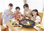 Parents and kids eating Japanese barbeque Stock Photo - Premium Royalty-Free, Artist: Photocuisine, Code: 670-03885856