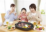 Parents and kids eating Japanese barbeque Stock Photo - Premium Royalty-Free, Artist: Janet Bailey, Code: 670-03885858