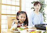 Mother and daughter eating Japanese barbeque Stock Photo - Premium Royalty-Free, Artist: Photocuisine, Code: 670-03885859
