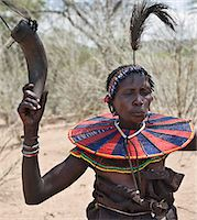 An old Pokot woman dancing during an Atelo ceremony. The cow horn container usually contains animal fat. Kenya Stock Photo - Premium Rights-Managednull, Code: 862-03888688