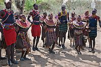 Young Pokot men and women dancing to celebrate an Atelo ceremony. The Pokot are pastoralists speaking a Southern Nilotic language. Stock Photo - Premium Rights-Managednull, Code: 862-03888689