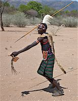 A Pokot warrior wearing a leopard skin cape celebrates an Atelo ceremony, spear in hand. The Pokot are pastoralists speaking a Southern Nilotic language. Stock Photo - Premium Rights-Managednull, Code: 862-03888690