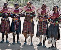Pokot women wearing traditional beaded ornaments and brass earrings denoting their married status. celebrate an Atelo ceremony. The Pokot are pastoralists speaking a Southern Nilotic language. Stock Photo - Premium Rights-Managednull, Code: 862-03888693