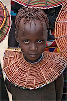 A young Pokot girl wearing a traditional broad necklace made of hollow reed grass that denotes her uninitiated status. The Pokot are pastoralists speaking a Southern Nilotic language. Stock Photo - Premium Rights-Managednull, Code: 862-03888699