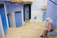 Woman resting in the bluish Chefchaouen medina. Morocco Stock Photo - Premium Rights-Managednull, Code: 862-03888903