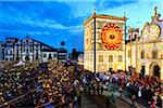 The main church and the procession of the Holy Christ festivities at Ponta Delgada in twilight. Sao Miguel, Azores islands, Portugal