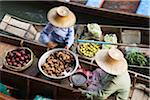 Thailand, Samut Songkhram, Damnoen Saduak.  Women trade produce from their canoes at Damnoen Saduak - Thailand's most famous floating market. Stock Photo - Premium Rights-Managed, Artist: AWL Images, Code: 862-03889867
