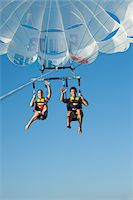 Couple Paragliding, Reef Playacar Resort and Spa, Playa del Carmen, Mexico Stock Photo - Premium Royalty-Freenull, Code: 600-03891039
