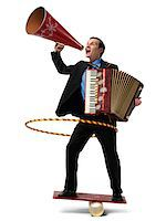 Businessman on Rocker Board Playing Accordian, Using Hula Hoop, and Yelling into Megaphone Stock Photo - Premium Rights-Managednull, Code: 700-03891174