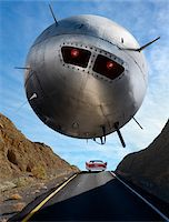 UFO Hovering Over Car on Highway Stock Photo - Premium Rights-Managednull, Code: 700-03891189