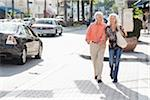 Couple Walking in Urban Setting Stock Photo - Premium Rights-Managed, Artist: Kevin Dodge, Code: 700-03891367